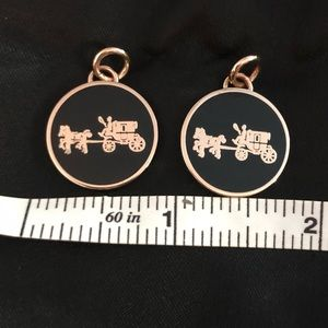 Two coach charms